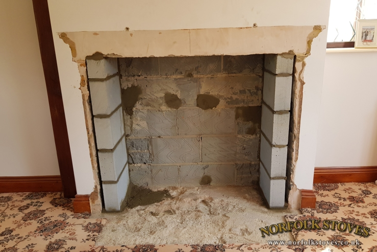 Shallow brick fire place removed