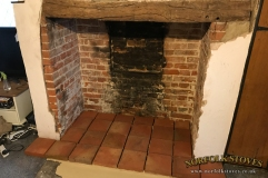 Pamment hearth ready to be pointed with original oak beam above