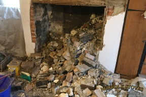 Fireplace excavation of a 1800 year old cottage