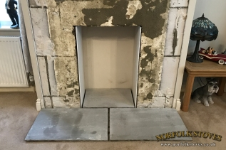 Fireplace remodel with fire board in place and Natural Stone hearth