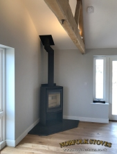 Di Lusso R5 Wood Burner on Corner Granite Hearth