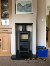 Heta-Inspire-45H-Log-Store-Granite-Hearth